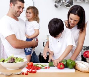 children_cooking_vegetables_with_parents